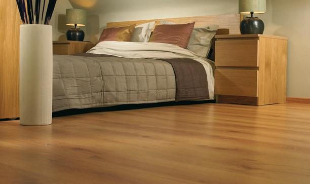 Цвет линолеума в спальне идеально сочетаться с расцветкой мебели