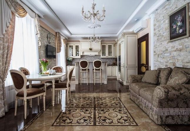 Красивая напольная плитка в интерьере кухни объединенной с гостиной